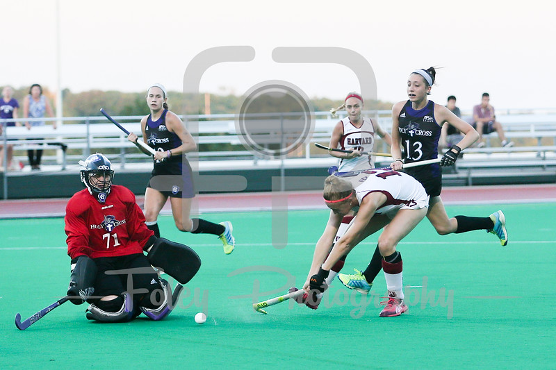 Harvard Crimson midfielder Mimi Tarrant (12) Holy Cross Crusaders goalkeeper Marcia LaPlante (71)