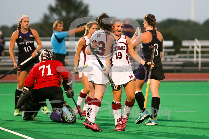 Harvard Crimson midfielder Tessel Huibregtsen (23) Harvard Crimson forward Kathleen Young (19)