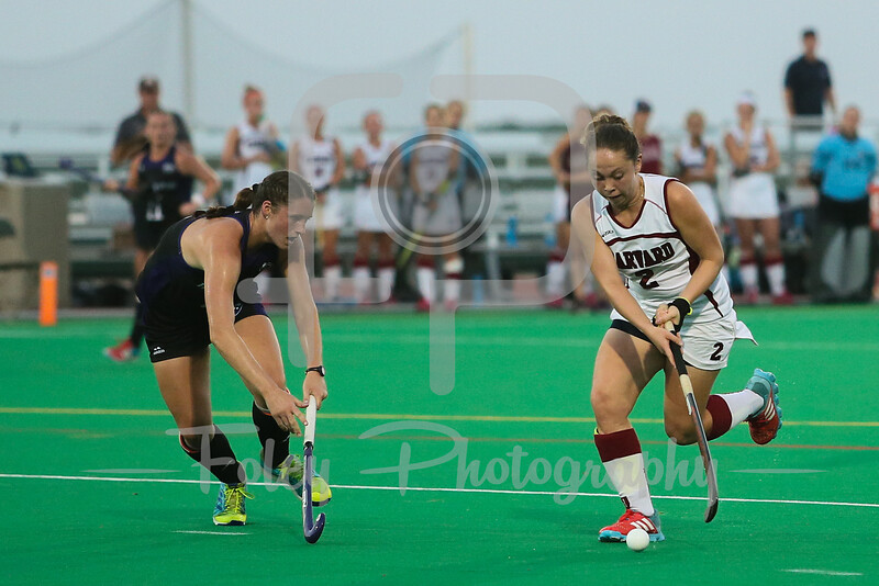 Harvard Crimson forward Maddie Earle (2) Holy Cross Crusaders midfielder Rachel Lapar (8)