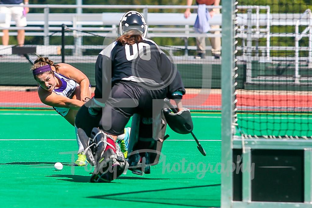 Holy Cross forward Maureen Connolly (19) Temple goalkeeper Chloe Johnson (00)