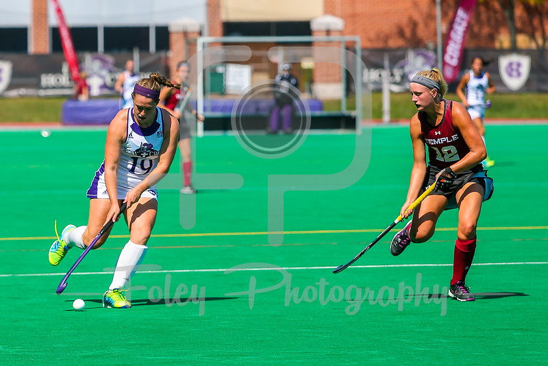 Holy Cross forward Maureen Connolly (19) Temple midfielder Becky Gerhart (12)