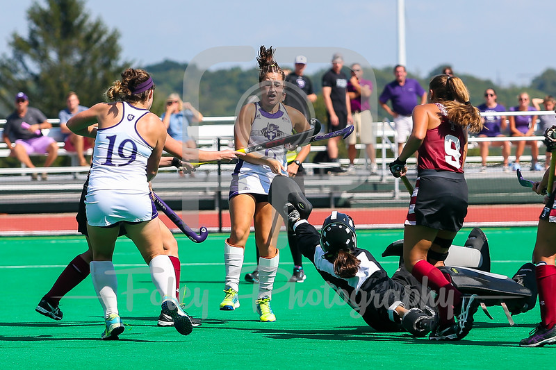 Holy Cross midfielder Emily Loprete (6) Temple fullback Nellie Doyle (15) Holy Cross forward Maureen Connolly (19) Temple goalkeeper Chloe Johnson (00)