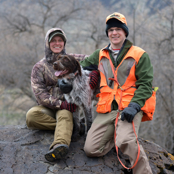 Rocky Mountain High<br /> Jen Lachowiec   (left) Benny of the Midnight Sun and owner Zeb Breuckman (right) pose on a large boulder in the Snake River Gorge during Benny's Utility Field <br /> Test.