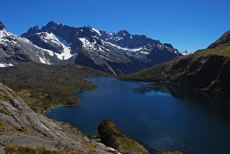 Lake Adelaide; Karetai Peak, Mount Revelation, Taiaroa Peak and Mount Tuhawaiki above.