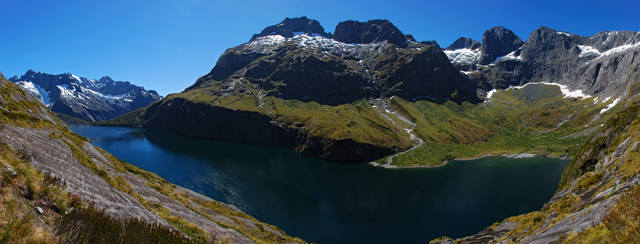 Lake Adelaide panorama. The peaks above are Mount Revelation (left), Mount Gifford (centre), Adelaide Peak, Sabre Peak, Marian Peak (right).