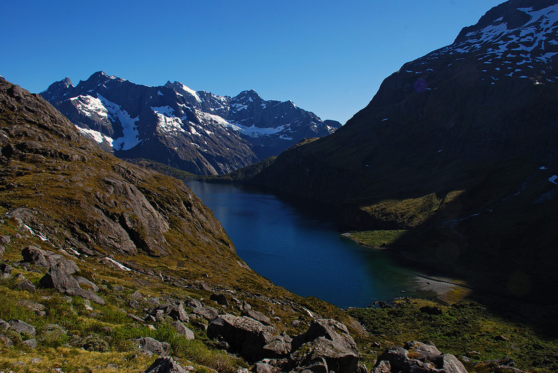 View of Lake Adelaide from Gill's Biv. From left to right on the skyline are Karetai Peak, Mount Revelation, Taiaroa Peak and Mount Tuhawaiki