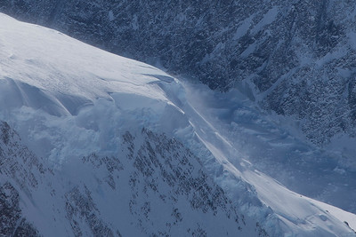 Strong katabatic winds blow snow off a ridge