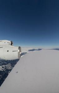 Flying over a large, tabular iceberg broken off the Larsen C ice shelf