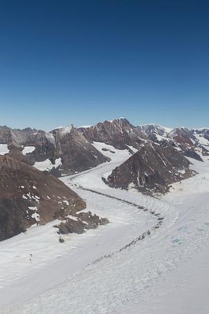 A small tributary flows into Crane Glacier