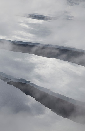 Openings in the ice along the edge of the Larsen C ice shelf