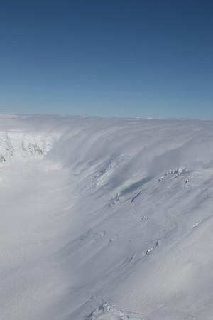 "Top of Drygalski Glacier; snow & clouds pour down off ""the waist""."