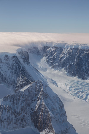 Clouds pour down off of Foster Plateau onto Hektoria Glacier
