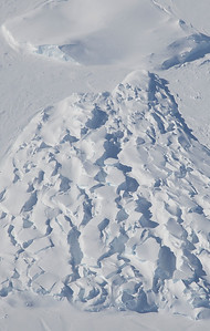 A heavily crevassed iceberg