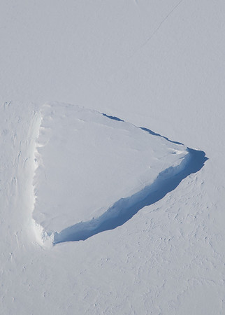 An iceberg confined by snow-covered sea ice