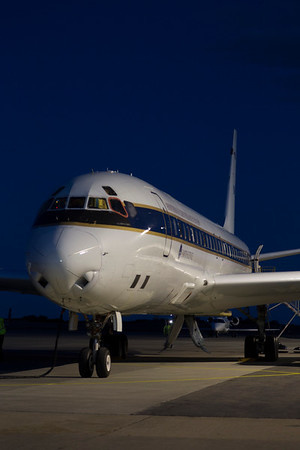 The NASA DC-8 sits under flood lights after another successful flight