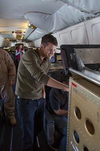 Scientist Alek Petty examines the aircraft data system
