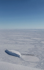 An Iceberg meets a sea ice floe, near Hull Glacier