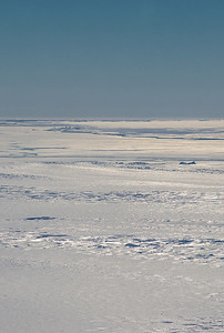 Looking out over Frostman Glacier at a sea ice covered Hull Bay