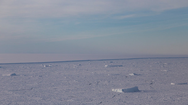 Looking back north across sea ice and small icebergs to the A68 iceberg
