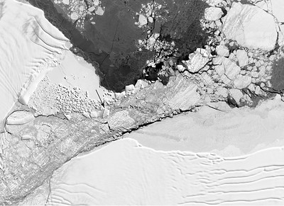 """Section of a Landsat 8 image of the """"square"""" iceberg area, with an arrow identifying the iceberg in question. Taken on Oct. 14th, 2018. (courtesy of Christopher Shuman)"""