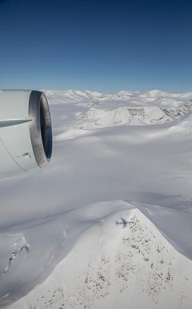 Flying over a mountain along Aphrodite Glacier