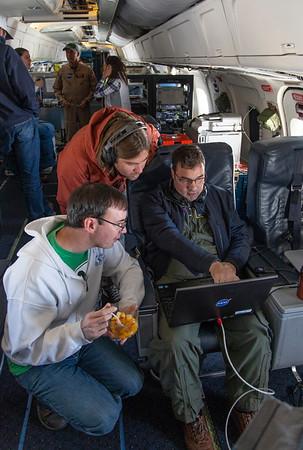 Michael shows Alexey and Matt experimental headwall data