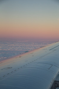Sunset reflections on the DC-8 wing over Stancomb-Wills Glacier