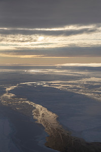 A setting sun reflects off leads in the central Weddell Sea