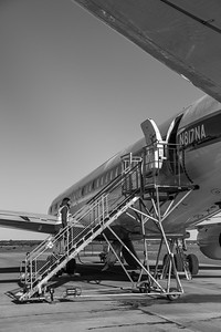 Alexey climbing on-board the DC-8 after cleaning the ATM nadir window