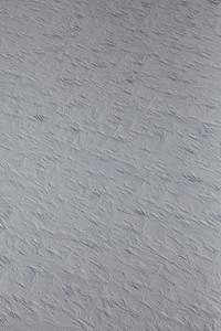 A close-up of snow dunes and sastrugi
