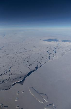 Loose and fast sea ice with icebergs near Veneable Ice Shelf