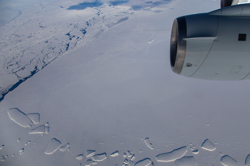 Skies clear during the start of our transit home to reveal sea ice and icebergs from the Veneable Ice Shelf