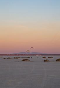 A couple paramotors fly over El Mirage in the pre-dawn
