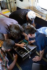 The ATM team troubleshooting a loose component