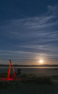 The GPS base station and the rising moon over a dusty El Mirage