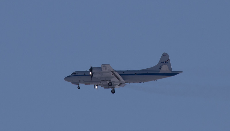 The NASA P-3 with gear down, coming in to land in Thule