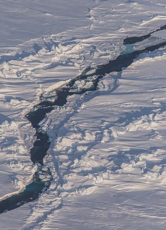 An open-water sea ice lead amongst rubble and ridges