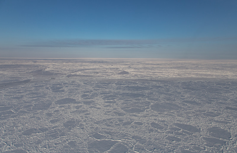 Medium size pans of ice in a heavily ridged area. NE of Greenland