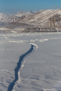 We fly over one of the many cracks in the glacier