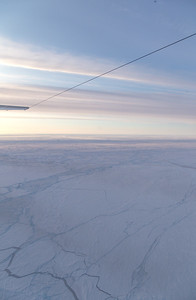 Snow-covered pack ice and refrozen leads north of Greenland