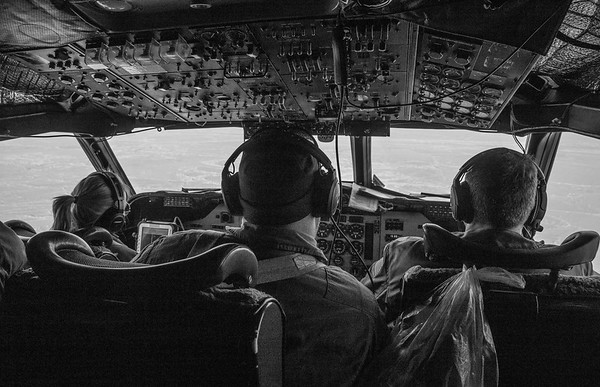 Pilots Jenny and Trey and Flight Engineer John over sea ice in the cockpit