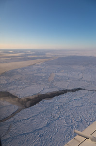 Floes interspersed with thin ice and leads releasing moisture to the air