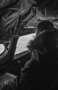 Claire watching sea ice pass by from the cockpit