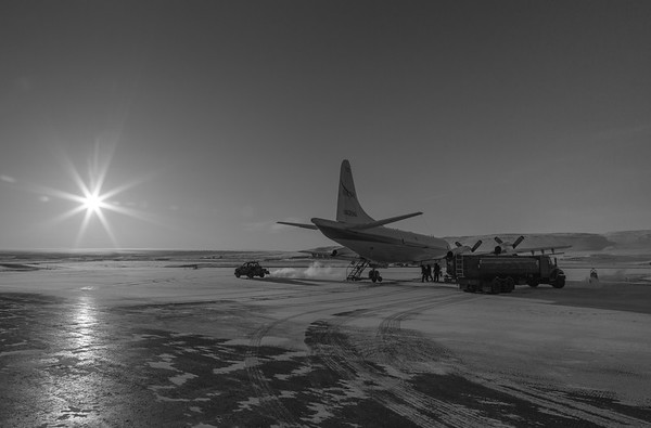 The P-3 prepping for flight on the Thule ramp in the morning sun