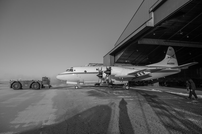 The P-3 being pulled out of the hanger for transit back to Wallops