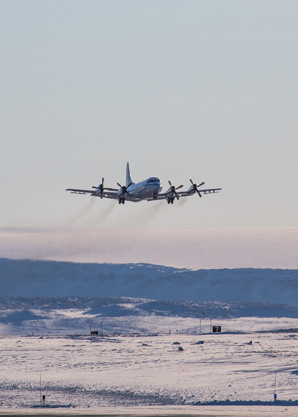 The P-3 just after takeoff, the Greenland ice cap in the background