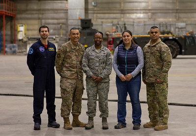 The base commander and her team with Joe and Eugenia