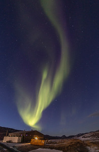 The Aurora over a building in Kanger and the Watson River
