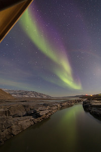 The Aurora reflecting off the Watson River