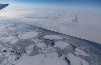 Sea ice floes in Nares Strait with Blanche Peninsula in the distance